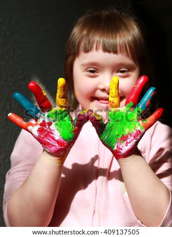 Cute little girl with painted hands. #409137505