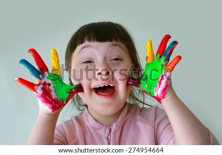 Cute little girl with painted hands. Isolated on grey background. #274954664