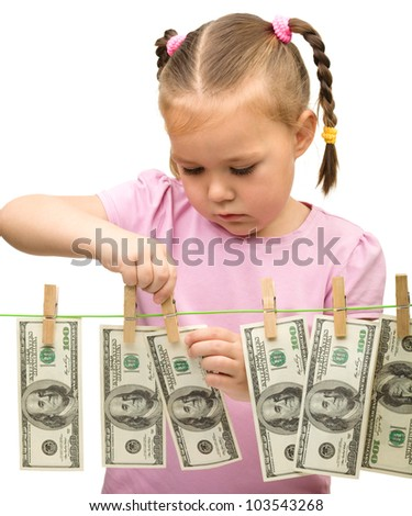 Cute little girl with paper money - dollars, isolated over white