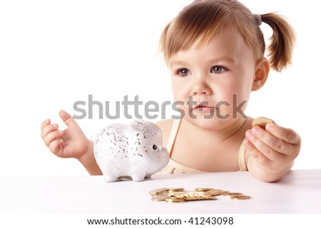 Cute little girl with piggybank, isolated over white
