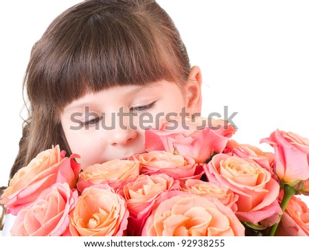 Cute little girl with pink roses on white background