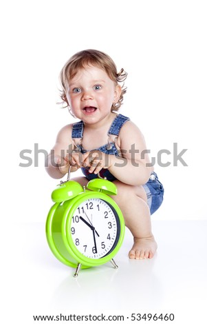 Cute little girl with the clock isolated on white background