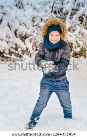 7f43ee342 Cute little happy boy outdoor in the winter. Child in winter clothes ...