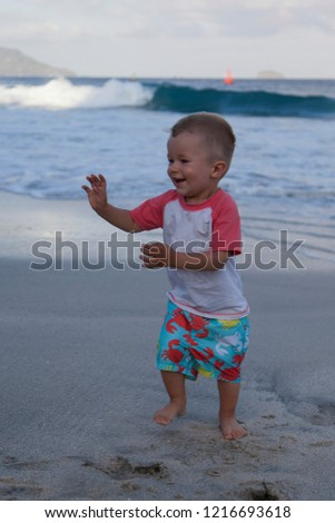 cf8e118cf Cute little happy funny baby boy is running, dancing, walking on the beach  with