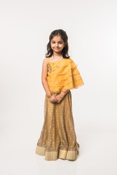 Cute little Indian/Asian Girl Child in traditional wear standing isolated over white background
