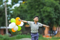 cute little indian boy with tri color balloons and celebrating Independence or Republic day of India