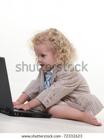 Cute little jewish boy playing with laptop
