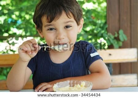 Cute little kid eating ice cream and enjoying