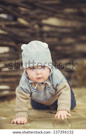 Cute little kid having enjoying countryside/ Outdoor