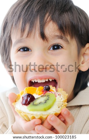 Cute little kid trying out delicous cake