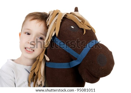 cute little kid with the plush toy horse