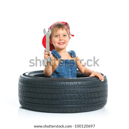 Cute little mechanic with a tire and wrench