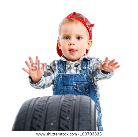 Cute little mechanic with a tire. Isolated on the white backround