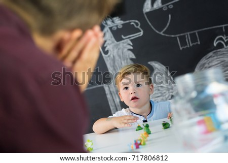 Cute little playfull toddler boy at child therapy session. Private one on one homeschooling with didactic aids. #717806812