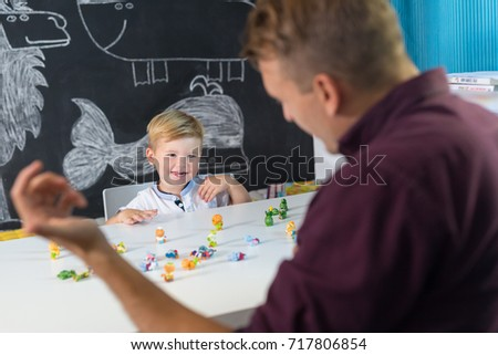 Cute little playfull toddler boy at child therapy session. Private one on one homeschooling with didactic aids. #717806854