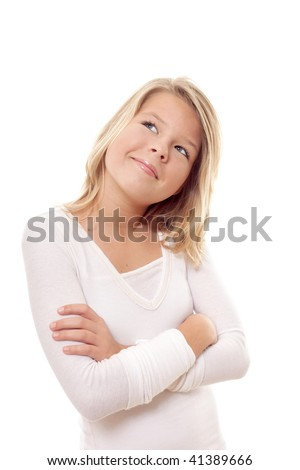 Cute little preteen girl thinking about something - stock photo