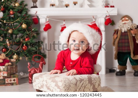 Cute little santa baby with New years gifts.Use it for a child, parenting or love concept. Happy new year