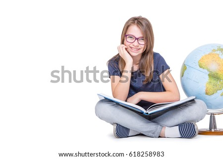 Cute little student girl with globe and book. Girl with glasses and teeth braces.