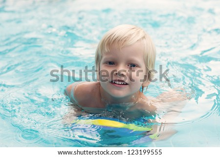 Cute little swimmer courageously overcoming water barrier