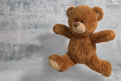 Cute Little teddy bear have fun jumping on white background with copy space
