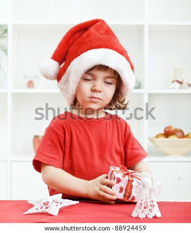 Cute little toddler wishing a Christmas wish with eyes closed