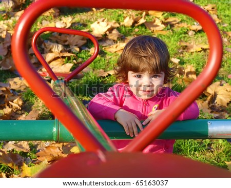 Cute looking child play in park