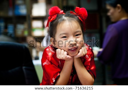 cute lovely sweet asian kid girl with smiling face in home background