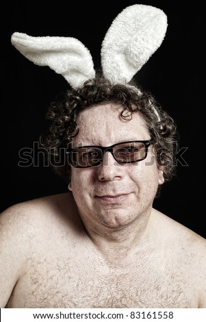 Cute man in glasses with white bunny ears and naked chest