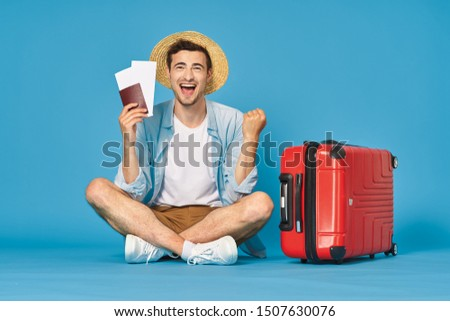 Cute man red suitcase passport plane tickets airport travel lifestyle lifestyle