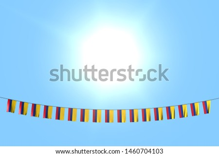 cute many Colombia flags or banners hanging on string on blue sky background - any celebration flag 3d illustration