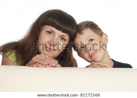 cute mom and son behind the sofa