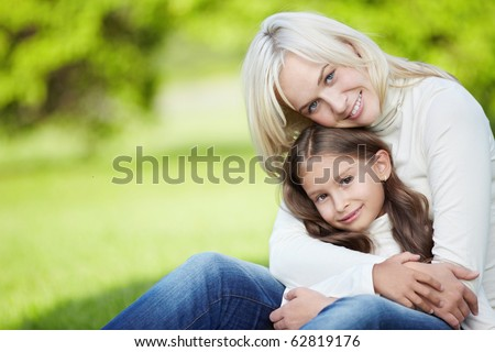 Cute mother and daughter outdoors