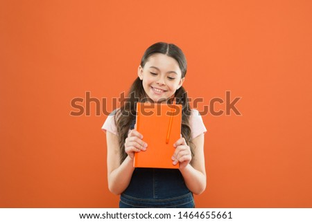 Cute nerd. Child hold book. Book store concept. Interesting literature. Development and education. Child care and happy childhood. Study at school. Reading hobby. Reading skills. Reading activity.