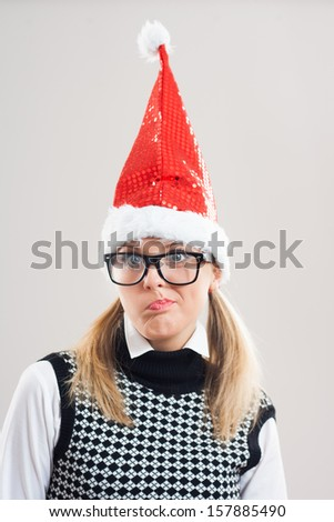 Cute nerd with santa hat is thinking,Nerd thinking