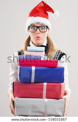 Cute nerdy woman is holding a lot of gifts and she is very excited,she can`t wait to open them,It`s time for presents!