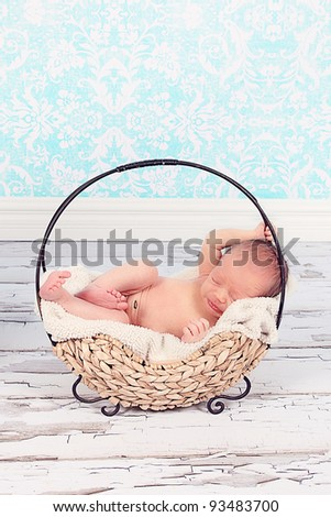 Cute newborn baby boy in Cute basket