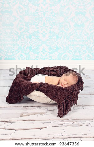 Cute newborn baby boy sleeping and posing for camera