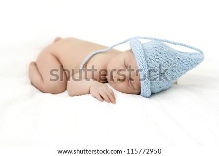 cute newborn baby in the cap gnome