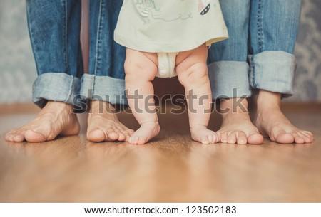 Cute newborn foot with family members