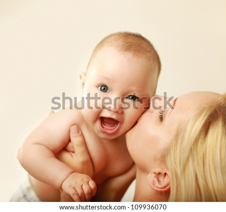 Cute newborn in mother's
