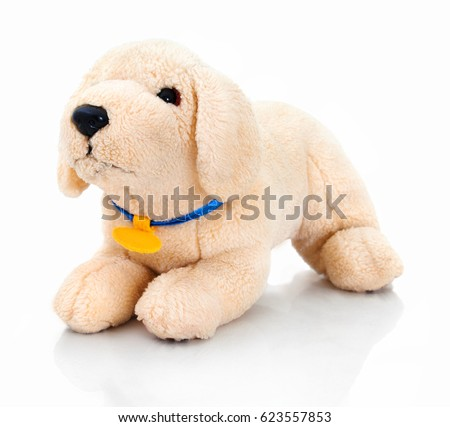 Cute ocher plushy dog doll in playful pose. Plushie dog isolated on white background with shadow reflection. Plushy pet dog on white backdrop. Spoonfed little dog in waiting for the game pose.  Сток-фото ©