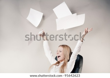 Cute office worker in chair with throwing away papers, with laugh