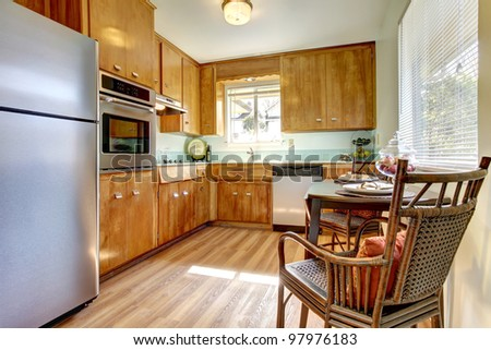 Cute old updated kitchen with blue tiles and new hardwood floor.
