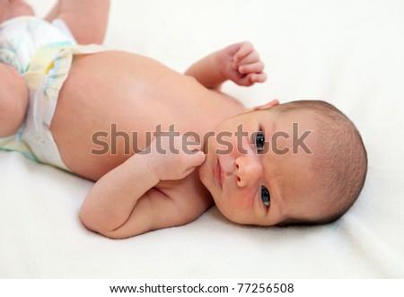 Cute one week old baby boy