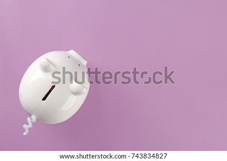 Cute piggy bank on color background stock photo