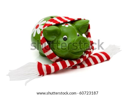 Cute piggy bank with a winter Christmas scarf isolated on white, Christmas Savings