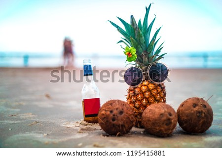 Cute Pineapple and Coconuts On Sunny Beach