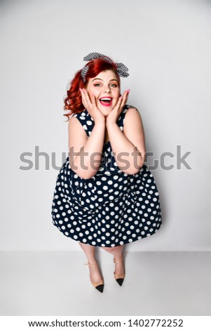 07cb496c8818 Cute portrait of a full-length red-haired woman plus size in a retro