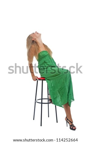 cute portrait of young caucasian blond woman sitting on high chair and laughing expressively isolated over white background