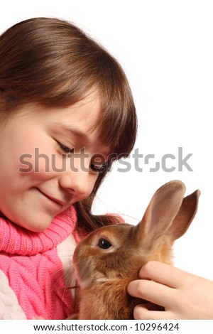 Cute preteen girl with pet rabbit, isolated on white background ...